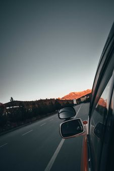 Free Left Grey Vehicle Side Mirror Reflecting Road Stock Image - 131518881
