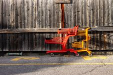Free Two Red And Yellow Shopping Carts Beside Wall Stock Photos - 131613313