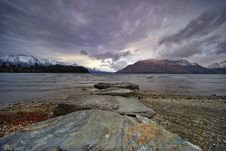 Free Body Of Water Overlooking Mountains Royalty Free Stock Photos - 131613378