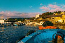 Free Blue Canoe Near Dock Stock Photo - 131613470