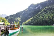 Free Parked Passenger Boat On Body Of Water Royalty Free Stock Images - 131719859