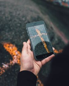 Free Close-Up Photo Of Person Holding Iphone Stock Image - 131720111
