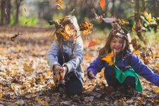 Free Photo Of Children Playing With Dry Leaves Stock Photos - 131860053