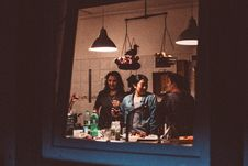 Free Three Women Standing Inside Room With Lights Turned On Stock Image - 131860121