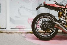 Free Red And Black Motorcycle Parked Near Wall Stock Image - 131860171