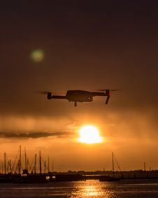 Free White Quad-copter Drone Flying Over Body Of Water During Golden Hour Royalty Free Stock Image - 131888976