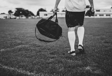 Free Person Walking On Field Holding Duffel Bag In Grayscale Photography Royalty Free Stock Images - 131889029