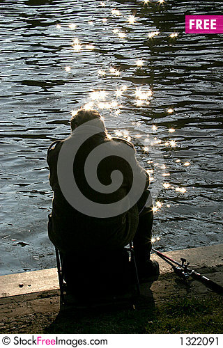 Angler in the evening sun Stock Photo