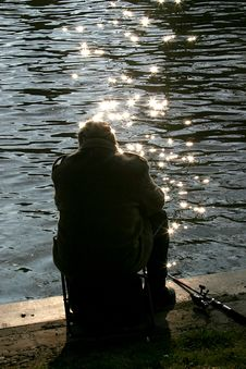Free Angler In The Evening Sun Stock Image - 1322091
