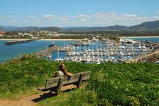 Girl Sitting On A Bench Overlooking The Marina Royalty Free Stock Photos