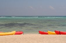 Free Beach, Ocean, Red And Yellow Kayaks Royalty Free Stock Photo - 1322785