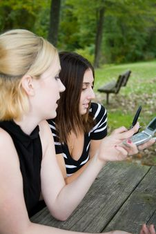 Free Friends On Cell Phone Together (Beautiful Young Blonde And Brune Stock Image - 1323071