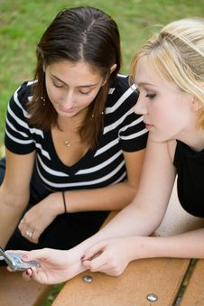 Free Friends On Cell Phone Together (Beautiful Young Blonde And Brune Stock Image - 1323161