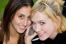 Friends On Cell Phone Together (Beautiful Young Blonde And Brune Stock Photos