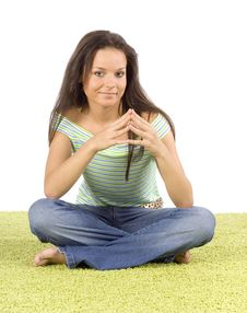 Young Woman Sitting On The Green Carpet Stock Image