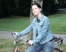 Free Young Woman With Bicycle Stock Images - 1324864