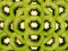 Free Kiwi Slices As A Background Image Royalty Free Stock Photography - 1328967