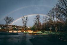 Free Rainbow Over Houses And Trees Royalty Free Stock Photos - 132036708