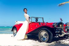 Free Photo Of Woman Standing Near Classic Car Royalty Free Stock Images - 132036749