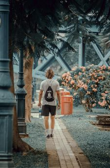 Free Man Walking On The Pathway In The Park Royalty Free Stock Image - 132036836