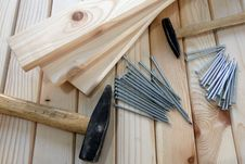 Free Gray Nails Beside Beige Wooden Planks And Hammers Stock Image - 132036931