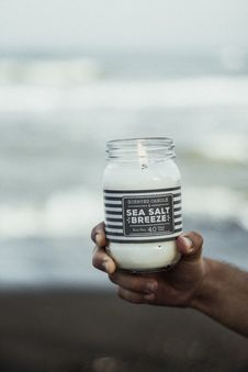 Free Photo Of Hand Holding Sea Salt Breeze Scented Candle Royalty Free Stock Photo - 132036955
