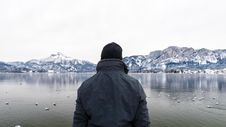 Free Person In Black Jacket Near Body Of Water Royalty Free Stock Photo - 132036995