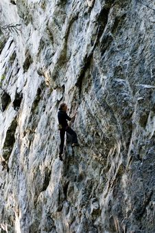 Free Person Climbing On Rock Mountain Stock Photography - 132037022