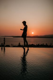 Free Silhouette Photography Of Person Standing On Swimming Pool Edge Stock Photography - 132106272