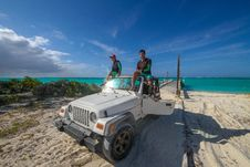 Free Two Men On White Jeep Wrangler Near Body Of Water Royalty Free Stock Image - 132106526