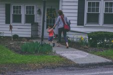 Free Woman And Boy In Front Of House Royalty Free Stock Photos - 132106658