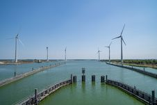 Free Windmill, Waterway, Wind Farm, Wind Turbine Royalty Free Stock Photos - 132189588