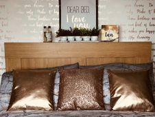 Free Three Brown Throw Pillows Royalty Free Stock Image - 132292996