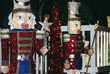 Free Two Nutcracker Figurine Near Fence Royalty Free Stock Photography - 132293047