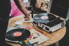 Free Person Near Vinyl Record Player On Brown Surface Royalty Free Stock Image - 132293106