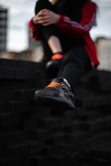 Free Person Wearing Black Nike Air Huarache Sneaker Stock Images - 132385864