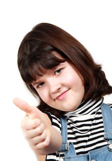 Free The Girl Shows A Thumb Upwards Royalty Free Stock Image - 13243046
