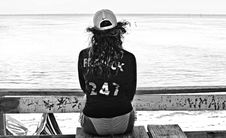 Free Grayscale Photo Of Woman In Bikini Sitting On Table Royalty Free Stock Image - 132568216