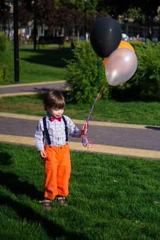 Free Photo Of Boy Holding Balloons Royalty Free Stock Photo - 132568275