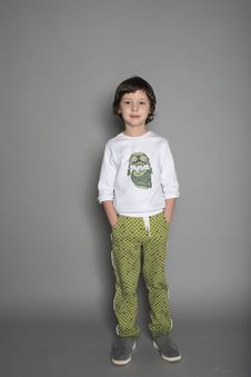 Free Boy Wearing White And Green T-shirt And Green Pants Royalty Free Stock Photos - 132568288