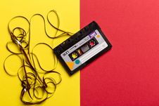 Free Black Cassette Tape On Top Of Red And Yellow Surface Stock Photo - 132568450