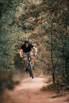 Free Person Riding A Bicycle Royalty Free Stock Images - 132568489