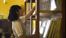Free Photo Of Woman Reaching For Book Stock Photography - 132670972