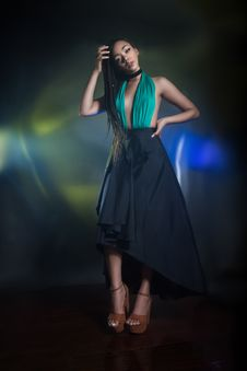 Free Standing Woman Wearing Teal And Black Halter Dress Royalty Free Stock Photos - 132760788