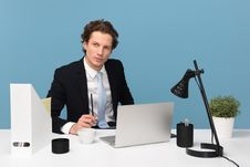Free Man Sitting With Laptop Computer On Desk And Lamp Stock Image - 132760801