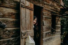 Free Woman Hiding Behind Cabin Door Royalty Free Stock Image - 132761056