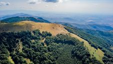 Free Bird S Eye View Of Mountain Cover By Trees Stock Photography - 132859392