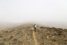 Free Man Walking On Top Hill Covered Of Fog Stock Image - 132859511