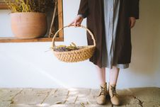 Free Woman Standing Holding A Basket Royalty Free Stock Photography - 132859847