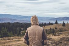 Free Person Wearing Brown Hooded Jacket Standing On Hill Near Trees Royalty Free Stock Images - 132859849